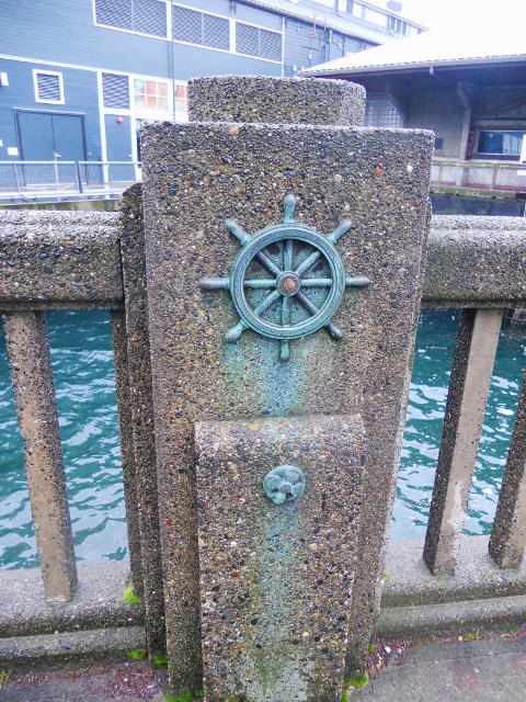 Ship's wheel architectural detail, Seattle (near the aquarium)